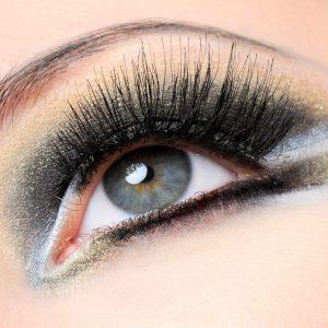 Creativity golden-brown modern make-up with long eyelashes